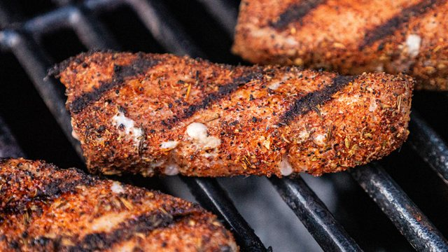 Grill marks on a seasoned piece of fish