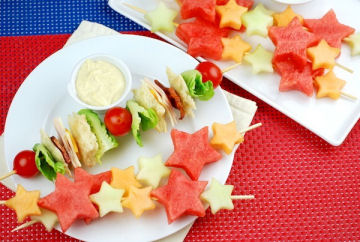 Shooting star melon skewers with yogurt dipping sauce