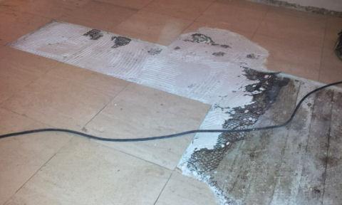breaking marble tile floors