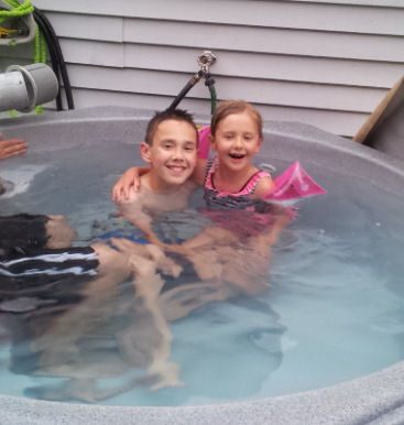kids in a hot tub