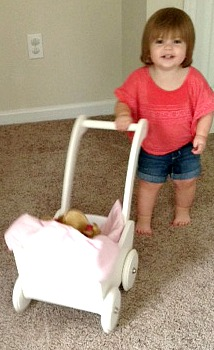 Savannah Smiling and Pushing Doll Buggy