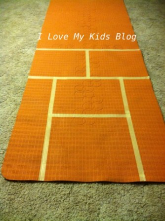 DIY Indoor hopscotch mat make lines