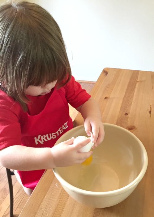 Krusteaz cracking an egg