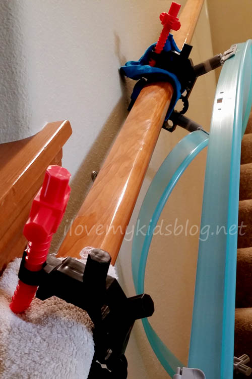 megatracks-clamps-secured-with-towels-to-protect-the-railing