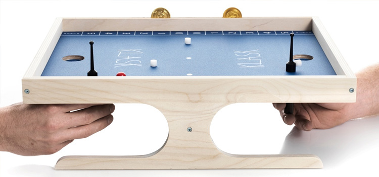 klask-pieces-are-moved-using-a-magnetic-holding-stick-that-connects-to-the-top-game-piece