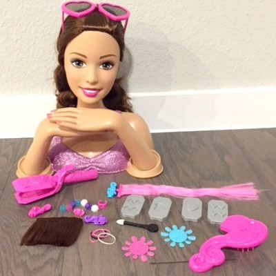Play Hairsylist this Christmas with Barbie Crimp and Color Deluxe Styling Head Doll