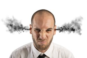 Concept of stress at work with businessman with smoke