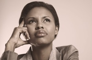 Young African American business woman looking away in a thought against a background
