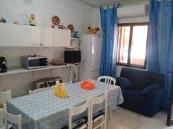 cucina villaggio isola blu trilocale