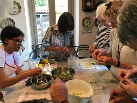 Sheryl and her friends peeling the fava beans