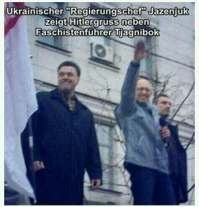 La scritta dice: il capo del governo Ucraino fa il saluto hitleriano accanto al leader fascista Tjagnibok