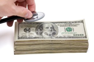 9423702-financial-health-money-and-stethoscope
