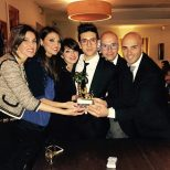 Sara Paci via Athina/LiJoy Piero holds the trophy with the Il Volo Canicatti Fan Club guys and gals