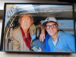 """Mary's daughter took this when Piero jumped in our cab. I had him sign it in July. It says, """"With love, Grande Amore, Piero."""""""