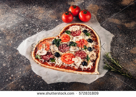stock-photo-heart-shaped-raw-pizza-with-tomatoes-and-mozzarella-for-valentines-day-on-vintage-concrete-572831809