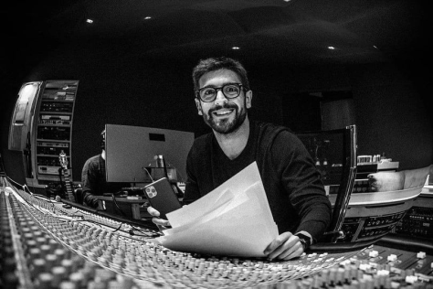 Piero in the recording studio seated in front of a control panel