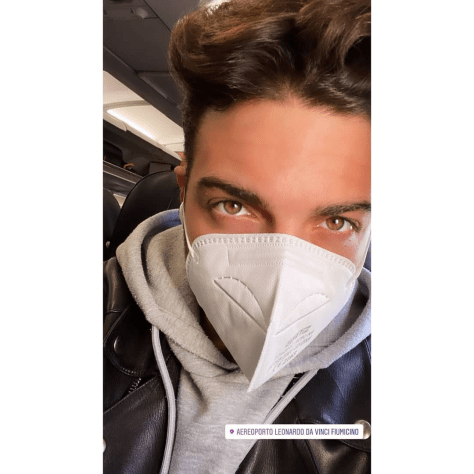 Gianluca with mask on at Rome airport
