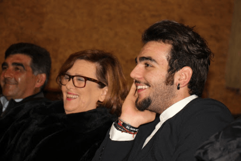 Left to right: Vito, wife Caterina and Ignazio sitting in an audience