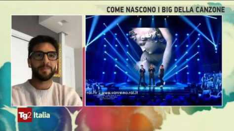PIero watching him and Gianluca and Ignazio sing on screen at Sanremo 2015