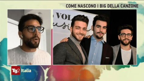 Piero speaking on screen with a photo of IL VOLO to his right
