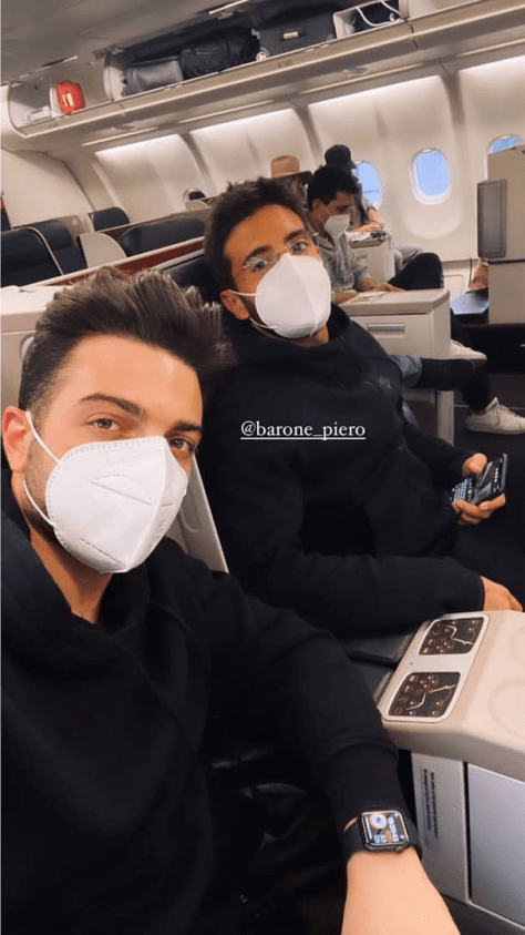 Gianluca and Piero in masks on the plane to Turkey