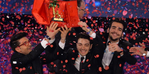 The guys of IL VOLO holding up the Sanremo trophy