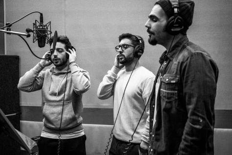 Black and white photo of Left to right: Gianluca, Piero and Ignazio singing in the recording studio