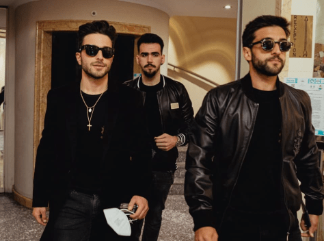 Left to right: Gianluca, Ignazio and Piero walking thru a hallway