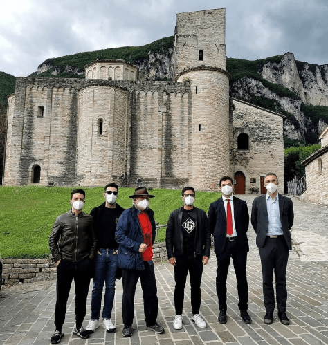 Gianluca, Ignazio and Piero with the president and dignitaries from the Marche region in front the Abbey of San Vittore in Genga