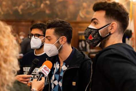 LeftLeft to right: Piero, Gianluca and Ignazio in masks being interviewed