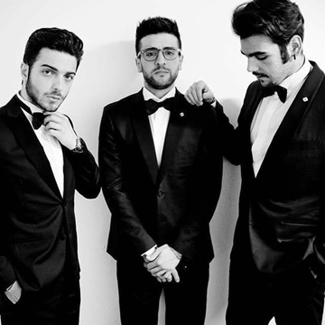 Left to right: Black and white photo ofGianluca, Piero and Ignazio in suits with bow ties