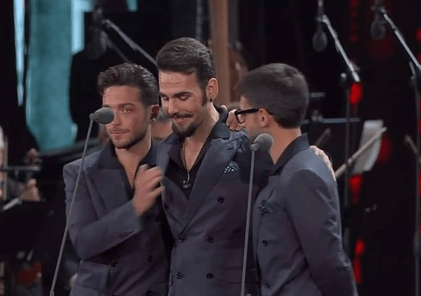 Left to right: Gianluca, Ignazio and Piero in an embrace on the arena stage