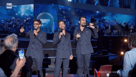 Left to right: Piero, Gianluca and Ignazio singing on the arena stage