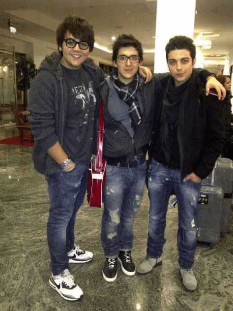 A young Ignazio, Piero and Gianluca standing in an airport