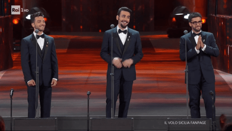 Left to right: Gianluca, Ignazio and Piero smiling on the arena stage
