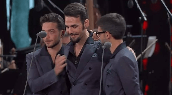 Left to right: Gianluca, Ignazio and Piero on stage in an embrace