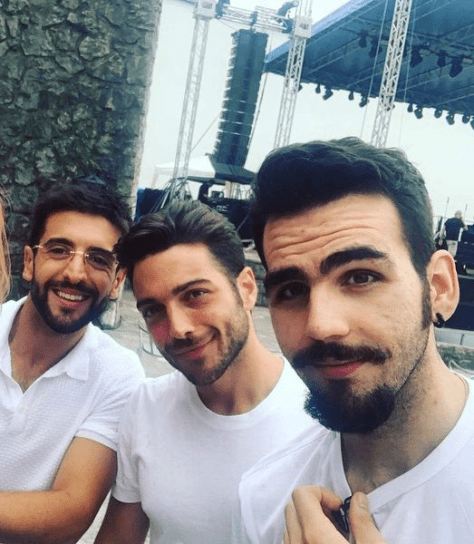 Left to right: Piero, Gianluca and Ignazio in white t-shirts before a concert