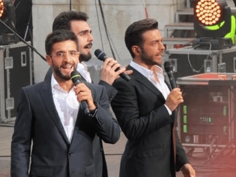 Left to right: Piero, Ignazio and Gianluca singing on stage