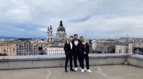 Gianluca, Ignazio and Piero on a rooftop with the city of Budapest in the background