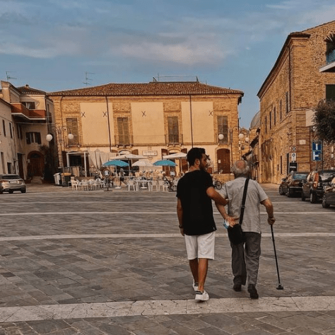 Gianluca helping his Nonno across the piazza in Montepagano