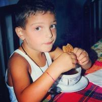 A young Gianluca eating a cookie