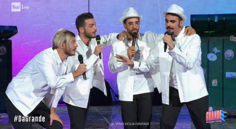 Cattelan and IL VOLO dressed in black pants and white jackets