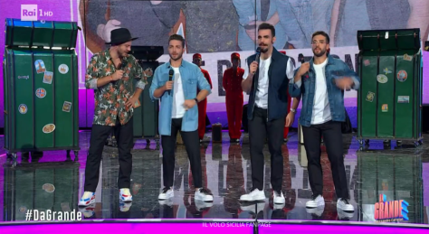 Cattelan and IL VOLO dressed in casual clothes on stage