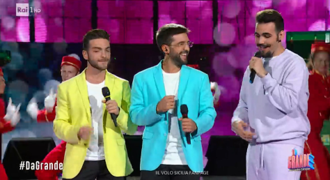 Left to right: Gianluca, Piero and Ignazio in brightly colored jackets and sweatshirt