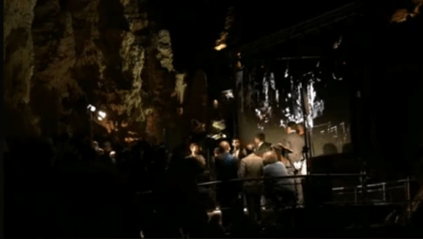 IL VOLO singing acapella in the caves with them on the big screen behind