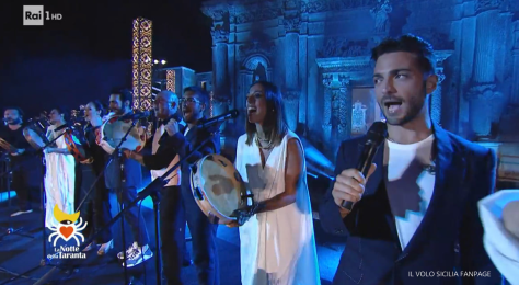 IL VOLO singing with other performers on stage