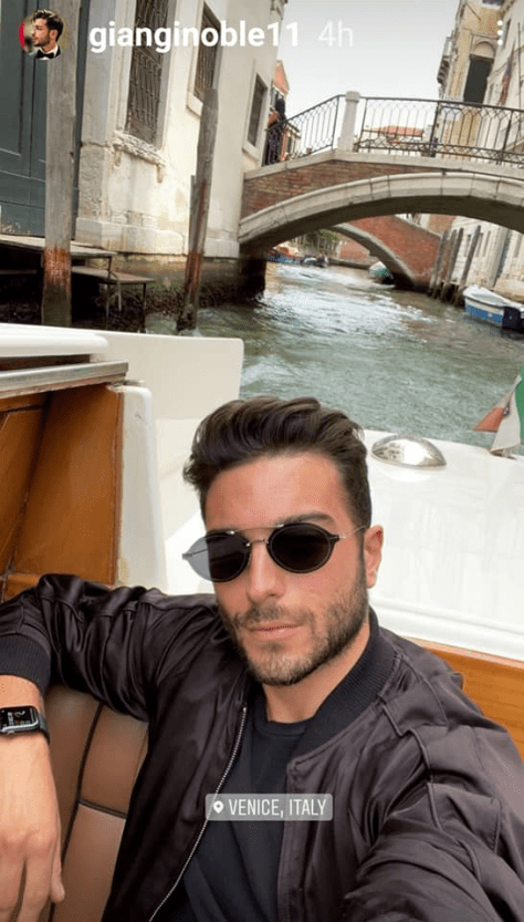 Gianluca in a boat on the Venice grand canal