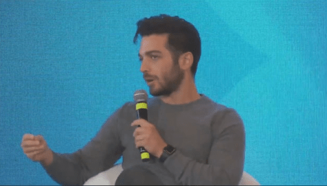 Closeup of Gianluca answering a question
