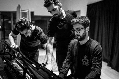 Black and white photo of the guys of IL VOLO at the piano