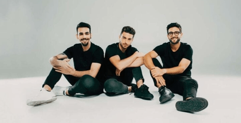 IL VOLO dressed in black sitting together on the floor